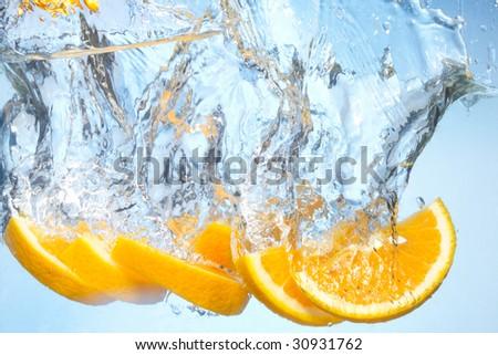 Orange under water - stock photo