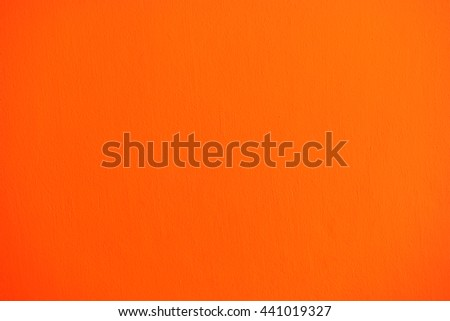 orange wall painted with brush texture. - stock photo