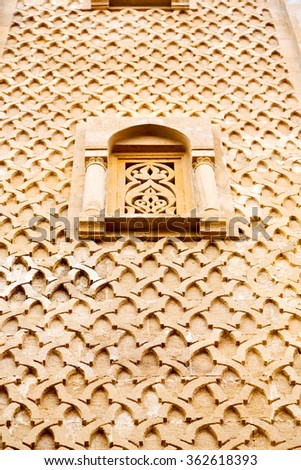 orange   window in morocco africa old construction and brown wall red carpet   - stock photo