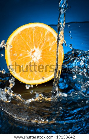 Orange with water splash - stock photo