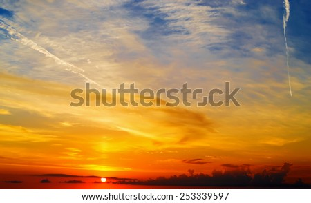 orange, yellow and blue scenic sky at sunset - stock photo
