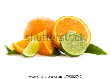 Oranges and limes - stock photo