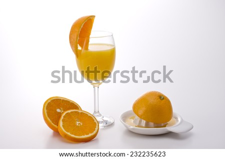 oranges are squeezed for fresh juice - stock photo