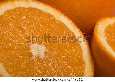 Oranges. Extreme Close-up of sliced oranges. - stock photo