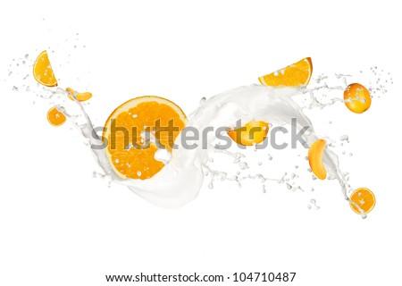 Oranges in cream splash, isolated on white background - stock photo