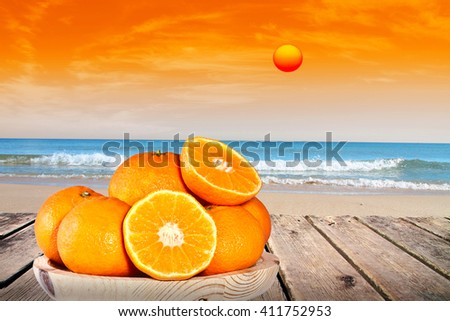 oranges in the beach - stock photo