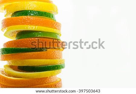 oranges, limes and lemons, fruit pyramid - stock photo