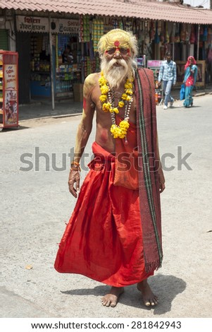 ORCHA,INDIA -  APRIL  24, 2015: A holy Sadhu man with traditional painted face in Orchha, Madhya Pradesh, India .April 24, 2015  - stock photo