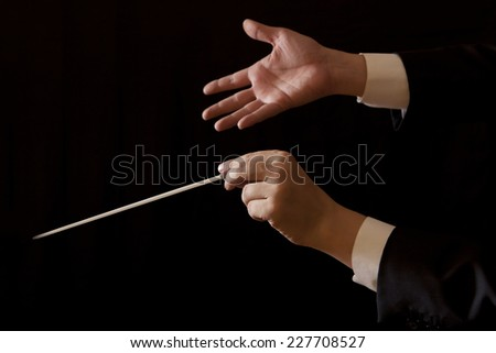 Orchestra conductor hands baton. Music male director holding stick - stock photo