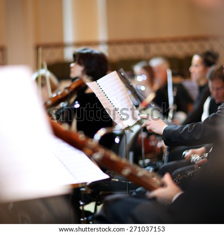 Orchestra musicians playing - stock photo