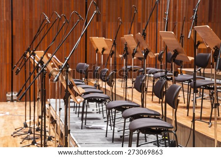 Orchestra stage with chairs and microphone - stock photo