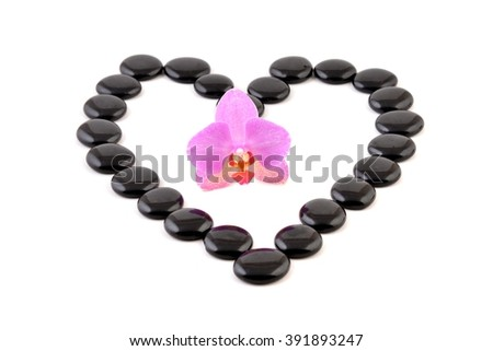 Orchid. Orchid flower, spa still life with pink orchid. Orchid and black stones. Orchid and pebbles - heart for love. Orchid and heart.  Orchid isolated on white.  - stock photo