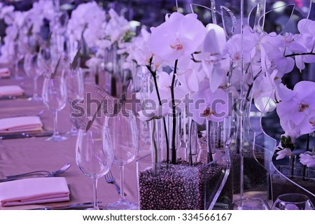 Orchid wedding decoration. White and gold colors. Wedding table for bride and groom. Glamorous Event, celebration  - stock photo