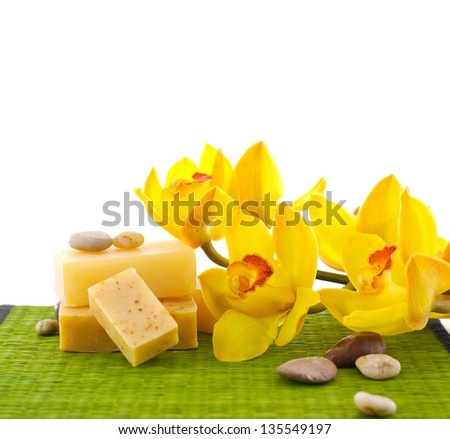 orchid with natural handmade soap on green mat - stock photo