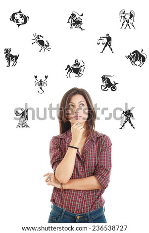 Ordinary casual beautiful woman surrounded with zodiac signs thoughtfully looking up with questionable face expression, photo conception problems with horoscope, good and bad sides and features - stock photo