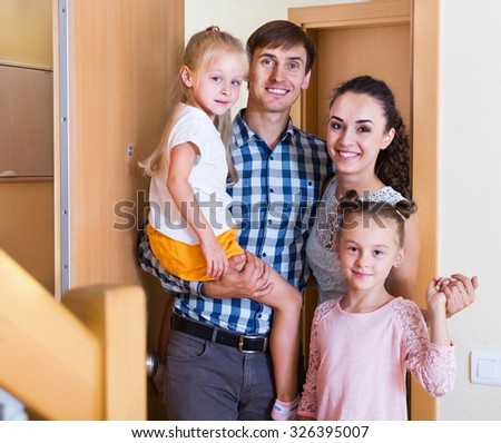 Ordinary middle class family moving in new house  - stock photo