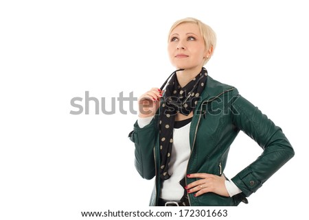 Ordinary young woman  in casual outfit thinking about something - stock photo