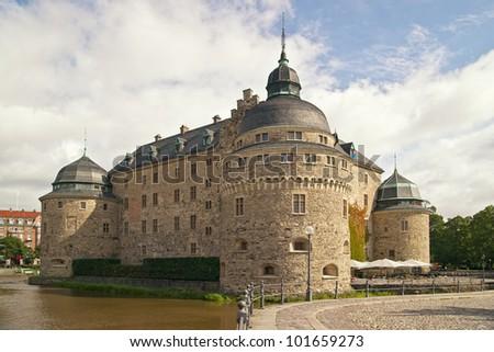 Orebro Castle. The medieval castle fortification in Orebro, Narke, Sweden. - stock photo