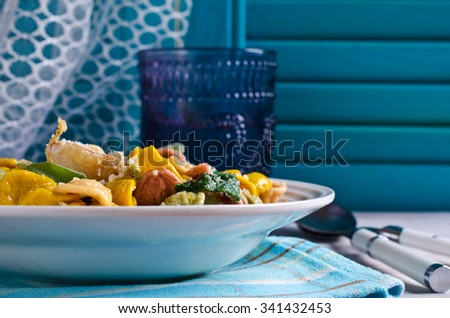 Orecchiette pasta of different colors with garlic and sage. Selective focus. - stock photo