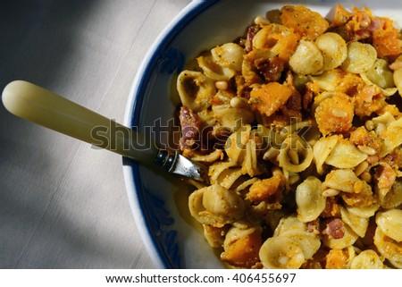 Orecchiette with squash, pesto and pine nuts  - stock photo