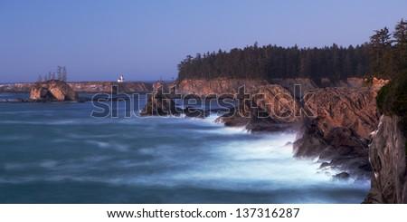 Oregon Coast near Coos Bay - Cape Arago Lighthouse - long exposure at twilight - stock photo