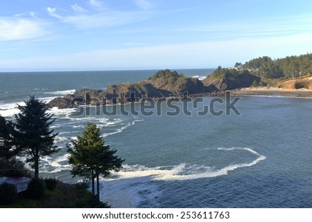 Oregon coast rocks and cliffs water inlet. - stock photo