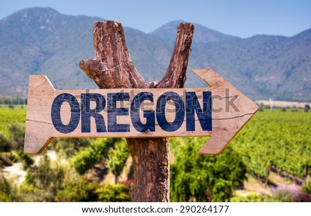 Oregon wooden sign with winery background - stock photo