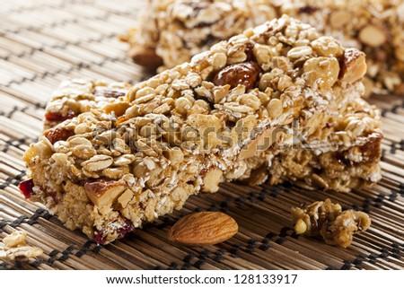 Organic Almond and Raisin Granola Bar on a background - stock photo