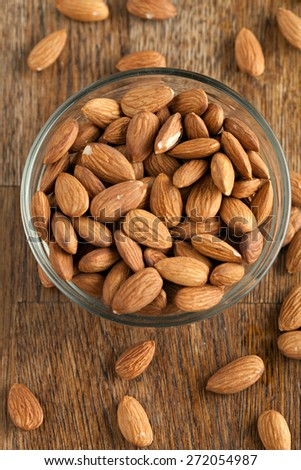 Organic almonds in raw form unroasted and unsalted.  Close up macro still life with a shallow depth of field. - stock photo