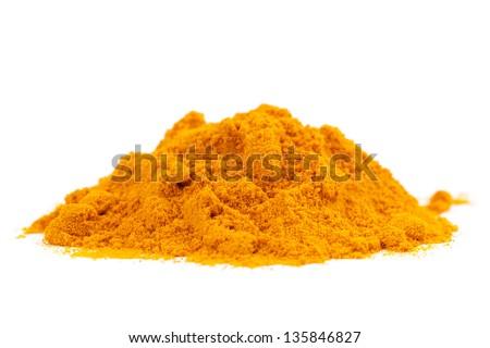Organic and raw curcumin / turmeric spice pile on white background - stock photo