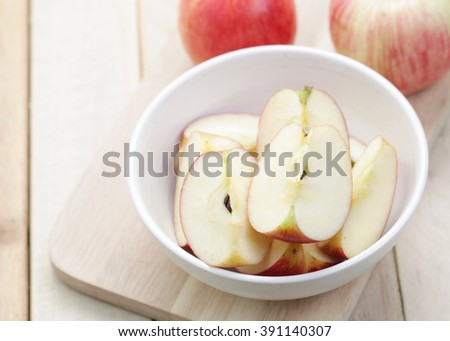 Organic apples sliced on wood table.The concept of food to lose weight. - stock photo