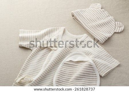 Organic baby clothes - stock photo