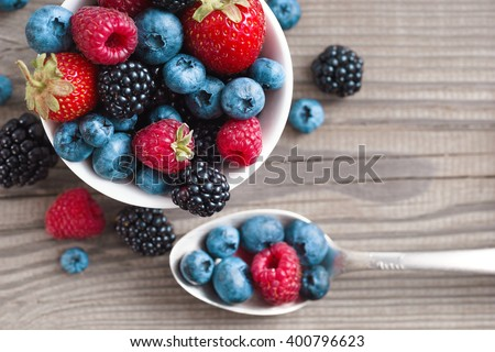 Organic berries on wooden table. Close up, top view, high resolution product. Harvest Concept - stock photo