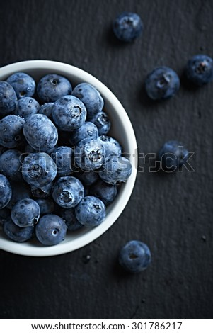 Organic blueberries in a bowl - stock photo