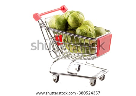 organic brussels sprouts in a small shopping trolley - stock photo