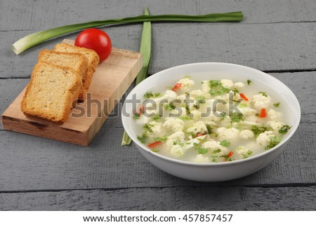 organic Cauliflower soup with toasted bread - stock photo