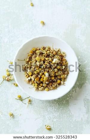 Organic chamomile (matricaria chamomilla) for tea - stock photo