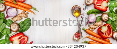 Organic clean vegetables assorted with cooking spoons and oil on white wooden background, top view, banner. Healthy  food, vegan or diet nutrition concept. - stock photo