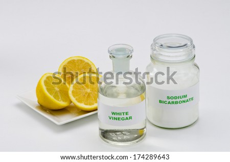 Organic cleaners. White vinegar, lemon and sodium bicarbonate. - stock photo