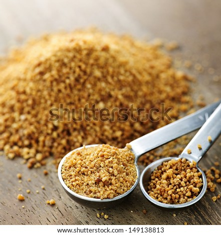 Organic coconut palm sugar in measuring spoons - stock photo