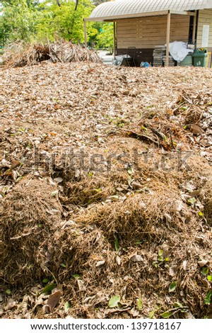 Organic Compost behind farm shack - stock photo