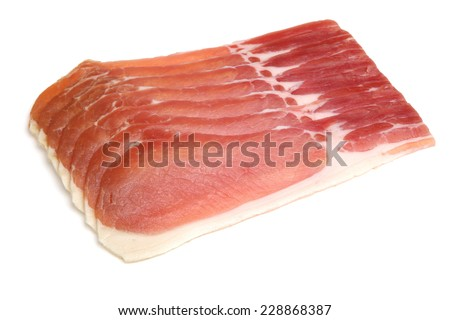 Organic dry-cured back bacon on white background. - stock photo