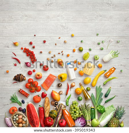 Organic food background. Studio photo of different fruits and vegetables on white wooden table. High resolution product. - stock photo