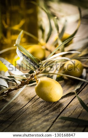 Organic food. Green olives with bottle of oil - stock photo