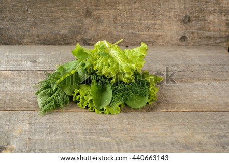 Organic food. ingredients for salad on old, rustic, wooden table. - stock photo
