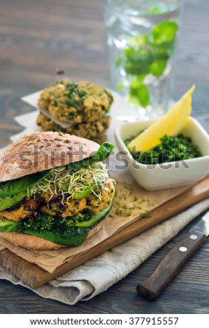 organic food: Vegan sourdough burger with sprouted greens and chickpea rissole - stock photo