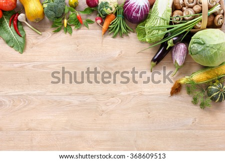 Organic foods background. Space for your text / high-res product, studio photography of different vegetables on old wooden table. - stock photo