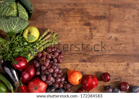 Organic foods background / studio photography of different fruits and vegetables on old wooden table  - stock photo