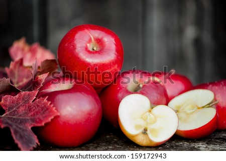 organic fresh apples on wooden background in autumn harvest at local farm. Agriculture concept theme with fresh apples in nature - stock photo