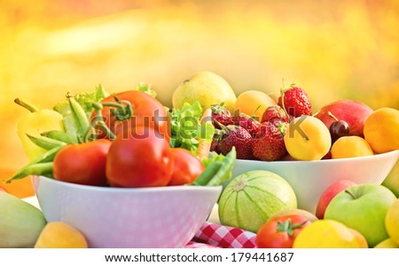 Organic fruits and vegetables in a bowls - stock photo